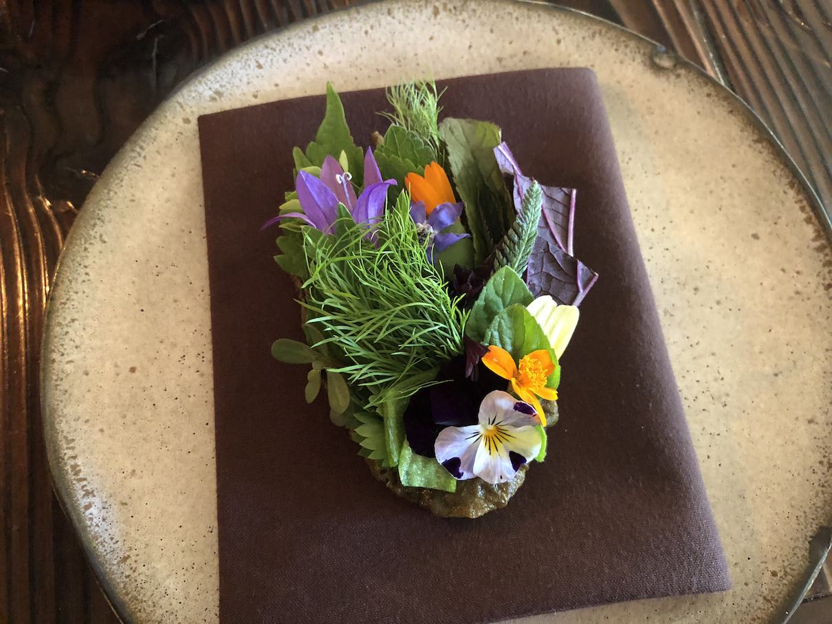 Flowers on a toasted something at The Willows Inn